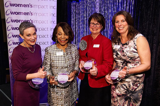 Group of women accepting Impact awards